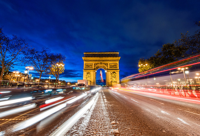 arc de triomphe streaming traffic at night travel caffeine